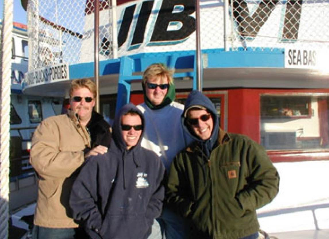 Some friends in front of the JIB VI fishing boat